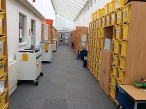 storage units with plastic boxes in the corridors
