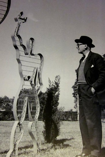 Photograph of Le Corbusier and Modulor